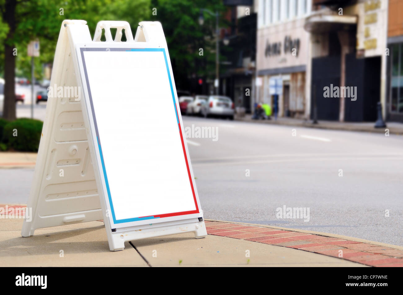 Blank billboard on a street corner for advertising - Stock Image