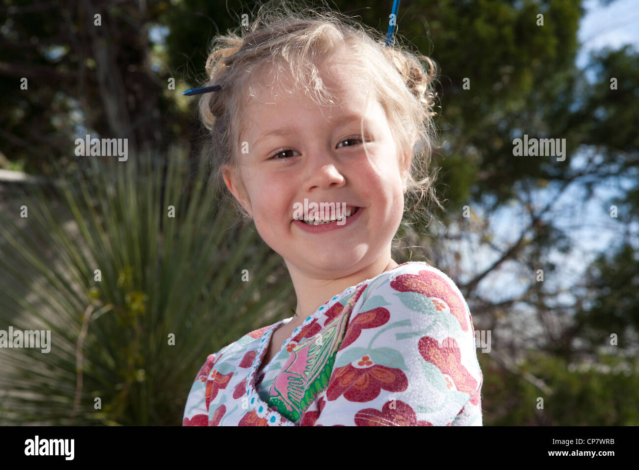 Five year old girl smiling confidently at the camera. Stock Photo