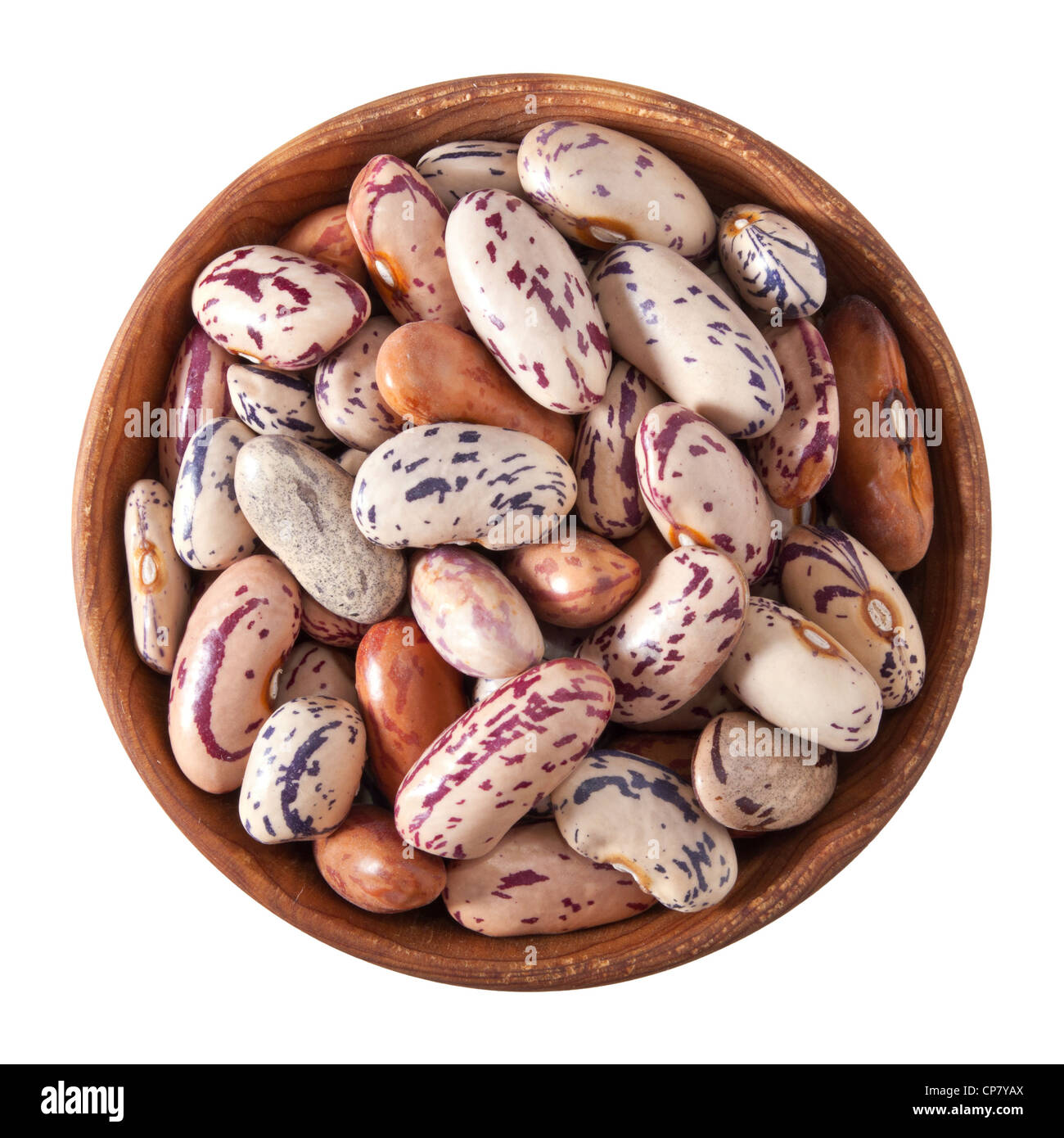 wooden bowl full of speckled beans isolated on white background - Stock Image