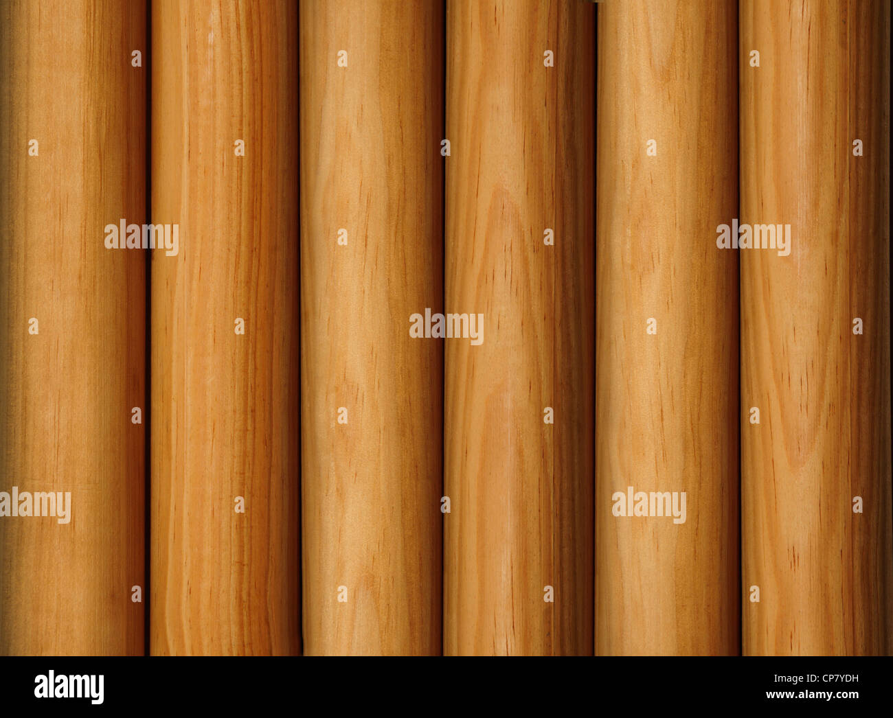 Wooden poles forming a background texture - Stock Image