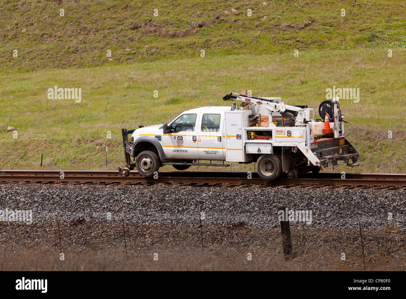 Hi-rail truck on train tracks - Stock Image