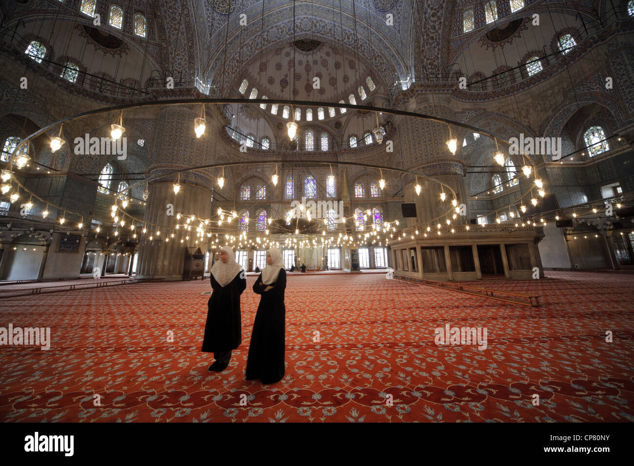 FEMALE MUSLIMS IN BLUE MOSQUE SULTANAHMET ISTANBUL TURKEY 27 March 2012 - Stock Image