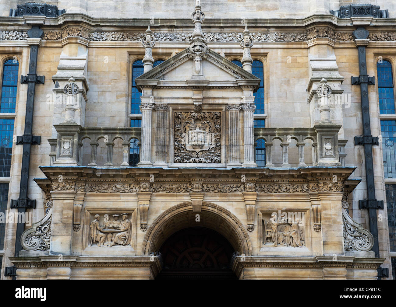Relief sculpture on the entrance to University of Oxfords Examination Schools Building. Oxford, Oxfordshire, England - Stock Image