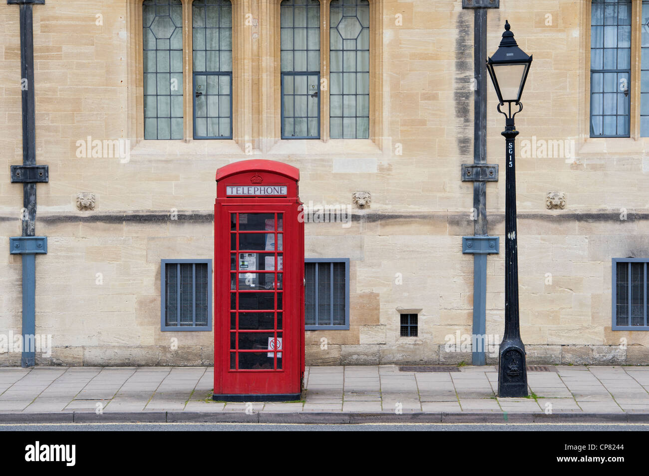 Red Telephone box and lamp post in St Giles, Oxford, Oxfordshire, England - Stock Image