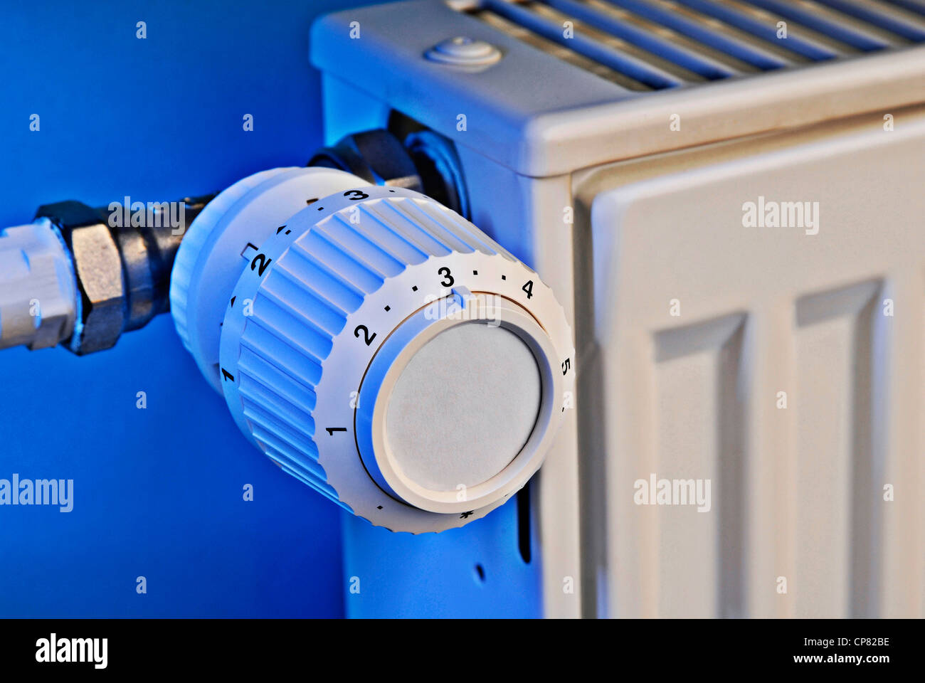 Close up of a heating thermostat. - Stock Image