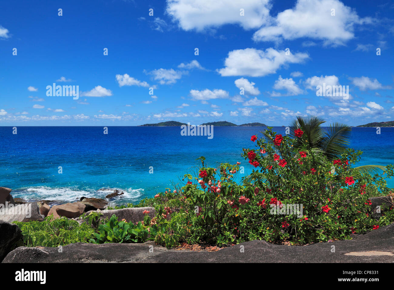 Tropical beauty of the Baie Ste Anne as seen from the north end of La Digue in the Seychelles - Stock Image