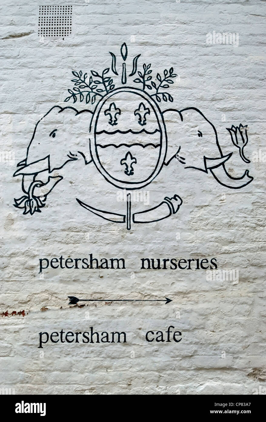 white wall with hand drawn crest and directions for petersham nurseries and petersham cafe, petersham, surrey, england Stock Photo