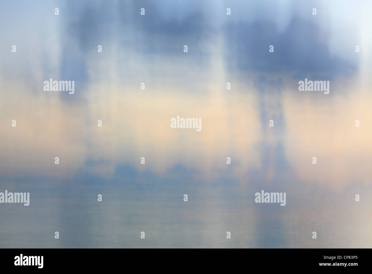 Impressionistic portrayal of early morning storm clouds over Mahe in the Seychelles - Stock Image