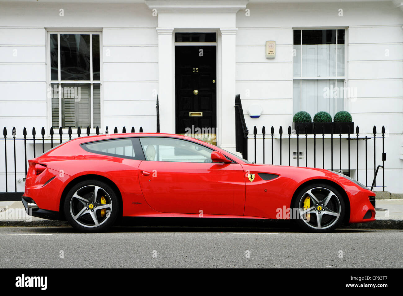 Red Ferrari FF sports car parked in affluent street, London borough of Kensington and Chelsea, UK Stock Photo