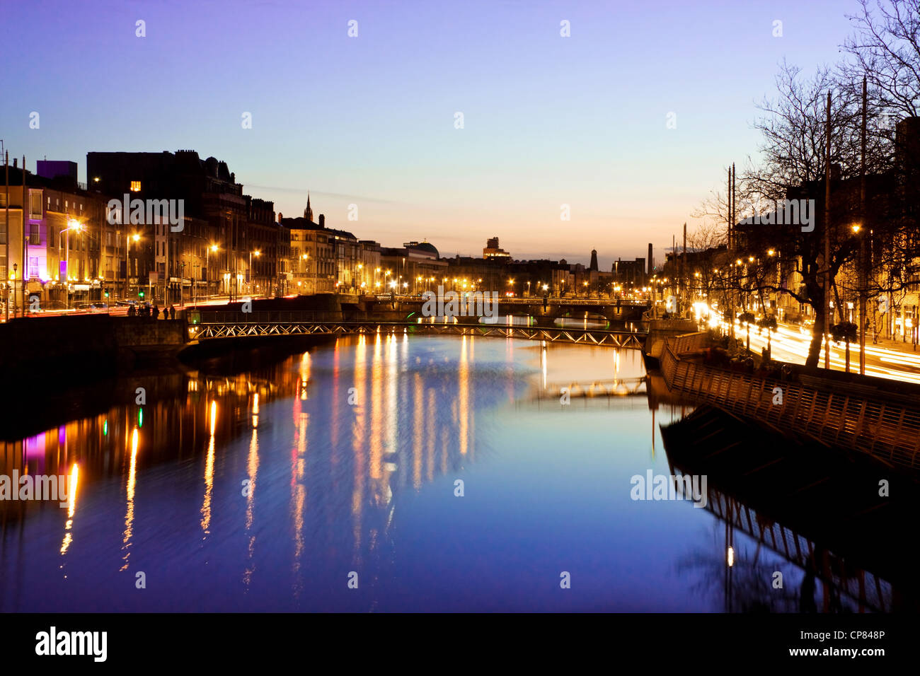 Dublin City at sunset - view over the river Liffey and historical Grattan bridge. Long exposure, tripod used. - Stock Image