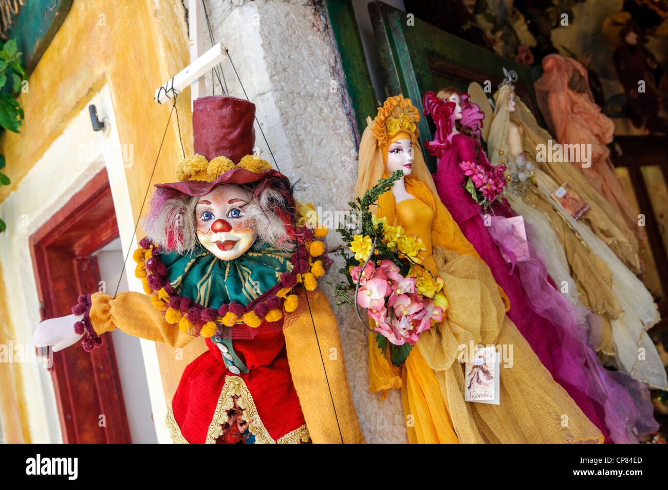 Colorful puppets on display outside a shop in Greece - Stock Image
