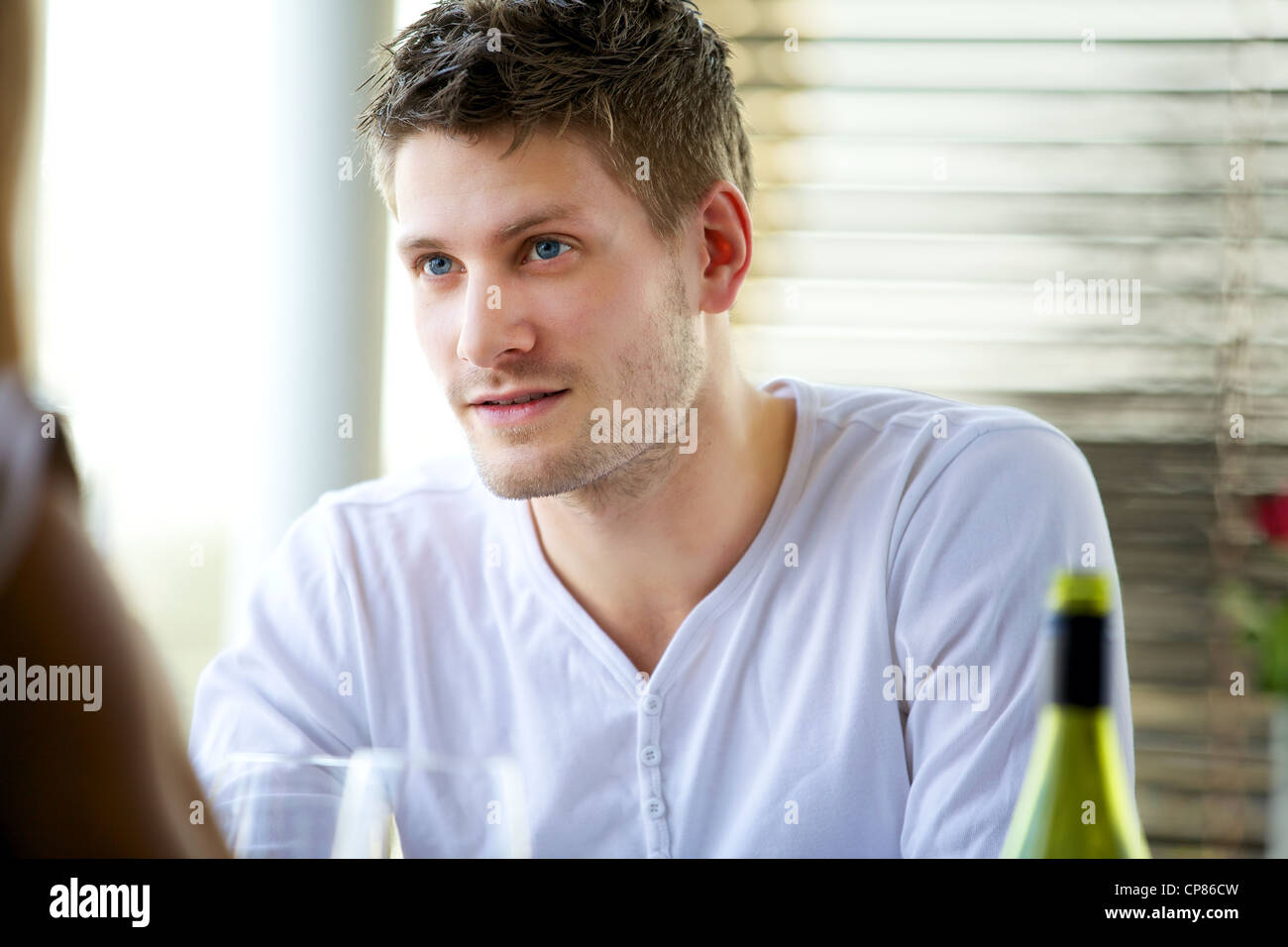 Portrait of an attractive guy seriously listening to someone Stock Photo