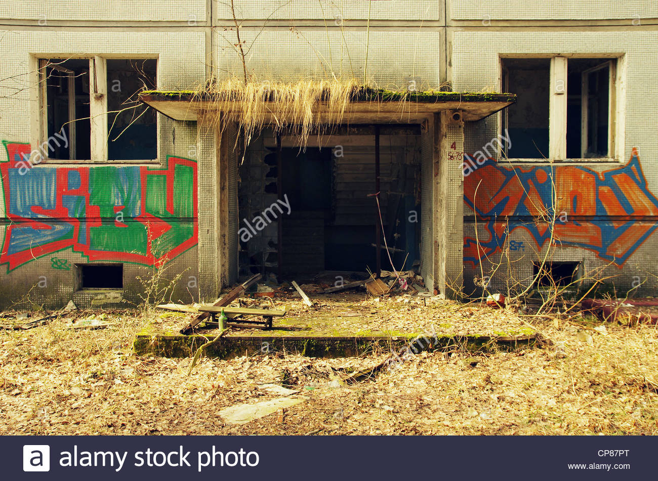 Block of flats covered with graffiti (former Red Army garrison town) Stock Photo