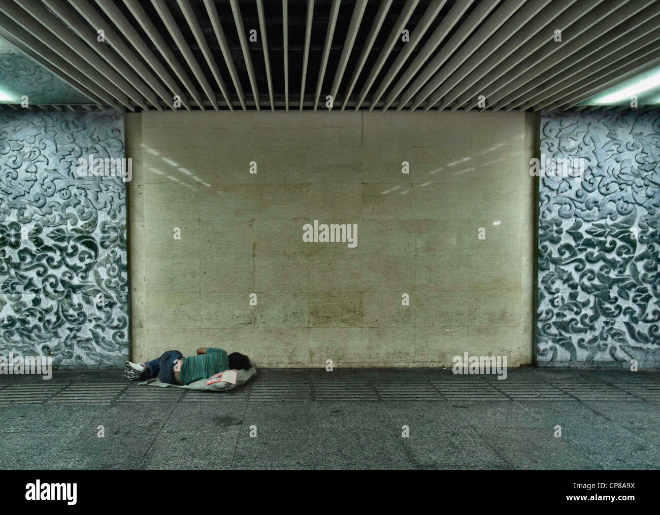 homeless person in subway in china - Stock Image