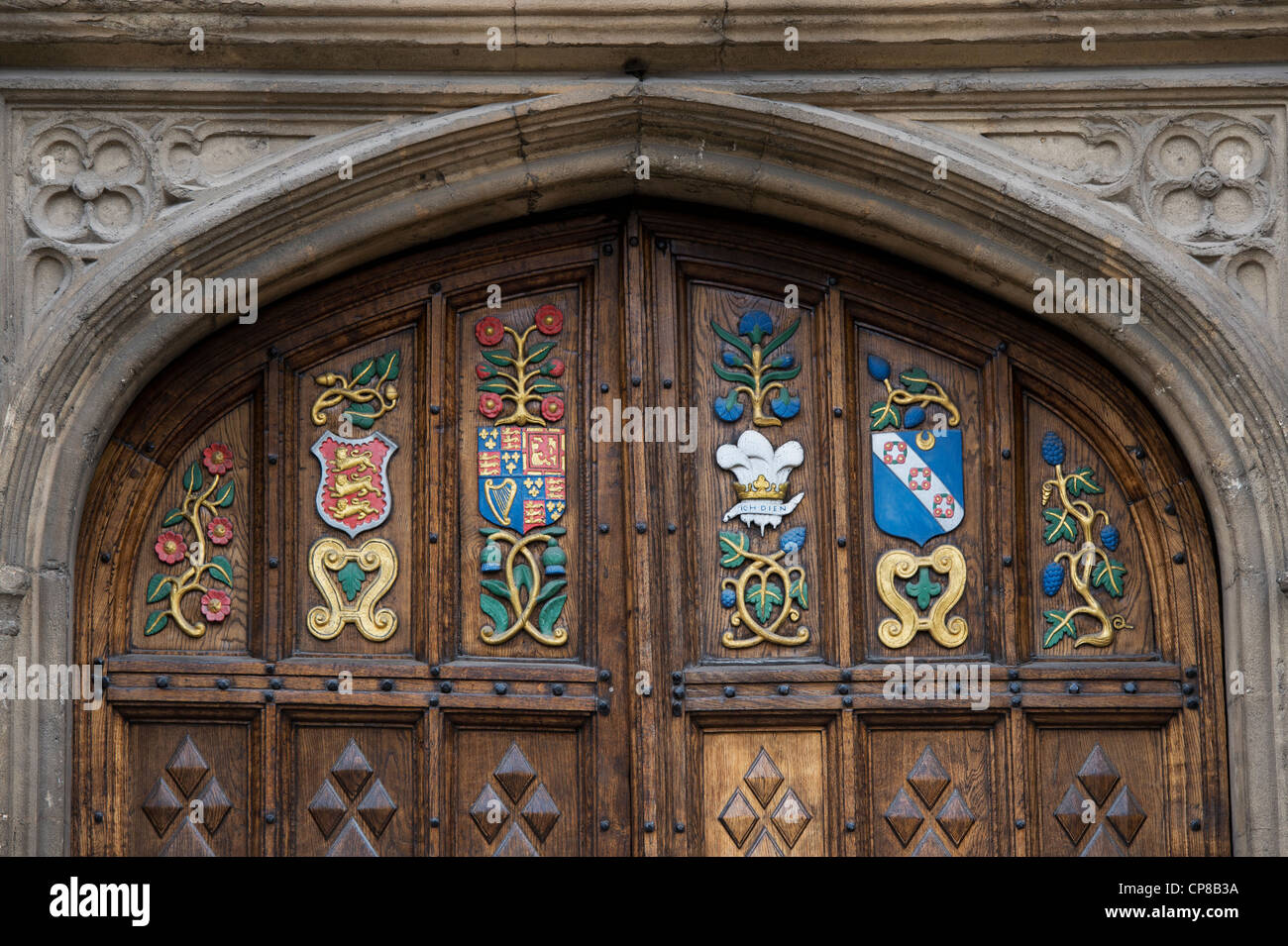 Oriel college, wooden doors / coat of arms carving details. Oxford, Oxfordshire, England - Stock Image