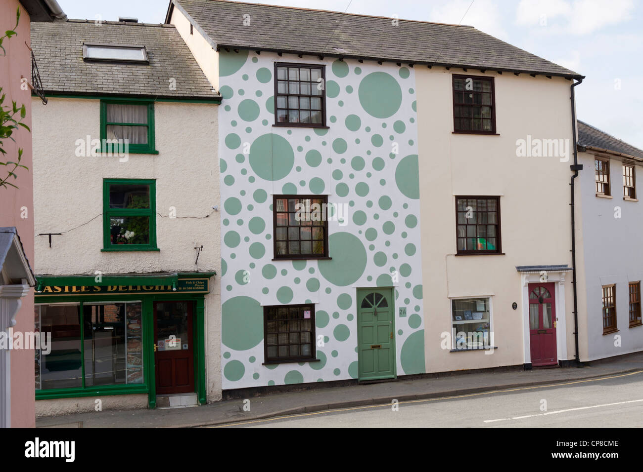Terraced house painted with spots in Bishops Castle Shropshire Stock Photo