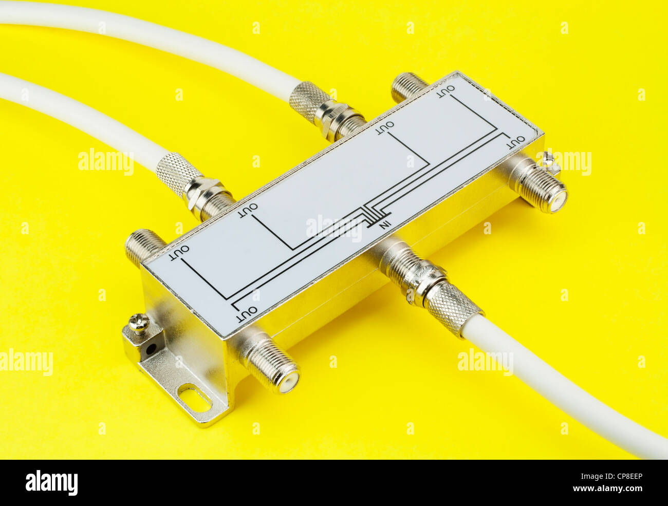 Electric switch device one input and six output on a yellow table. Mass production - Stock Image