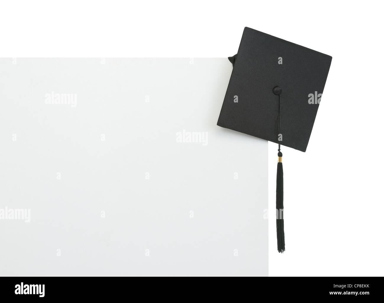 Graduation cap on blank billboard - Stock Image