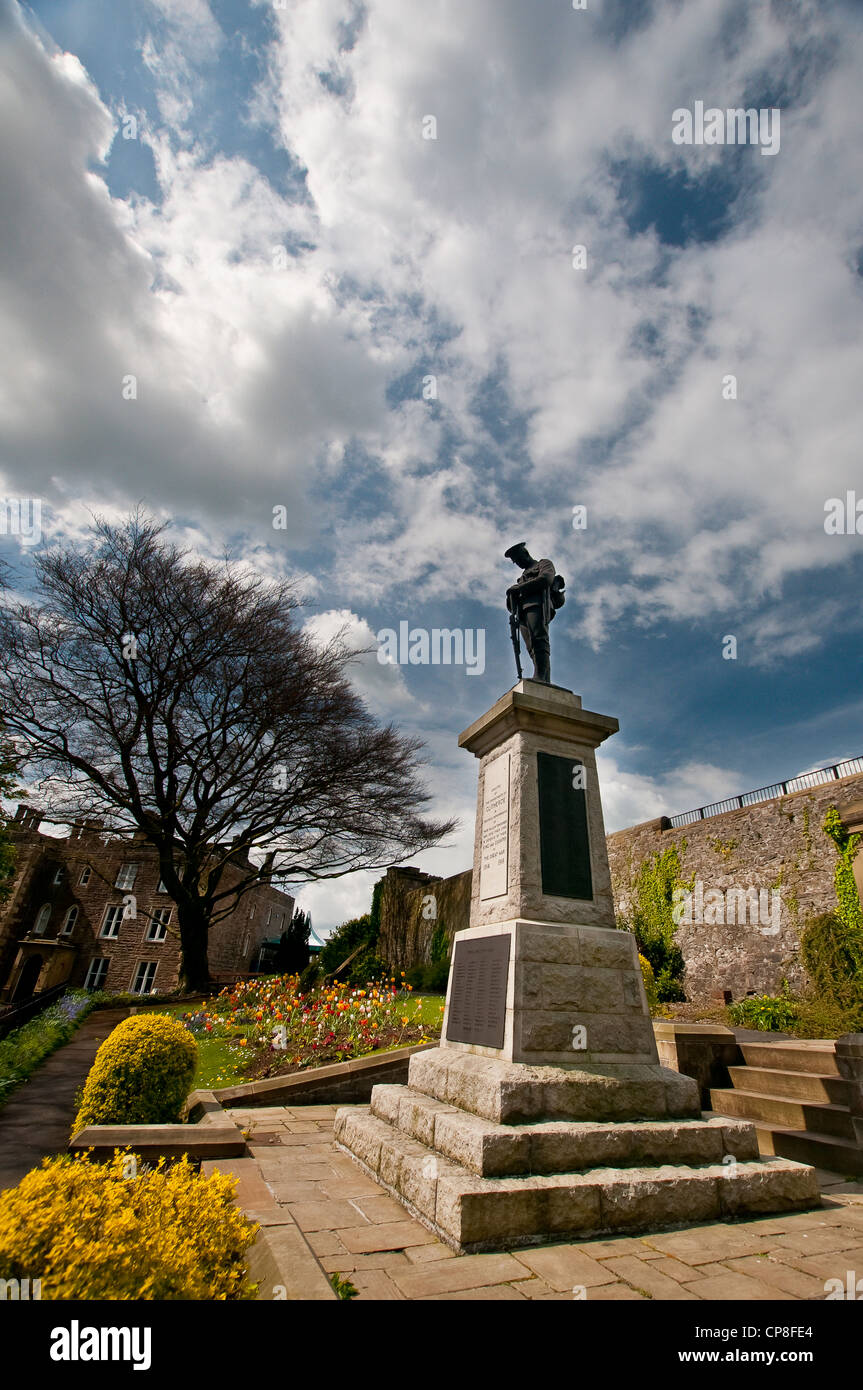 War memorial in Clitheroe Castle park, Lancashire, on a sunny day with cloudy sky - Stock Image