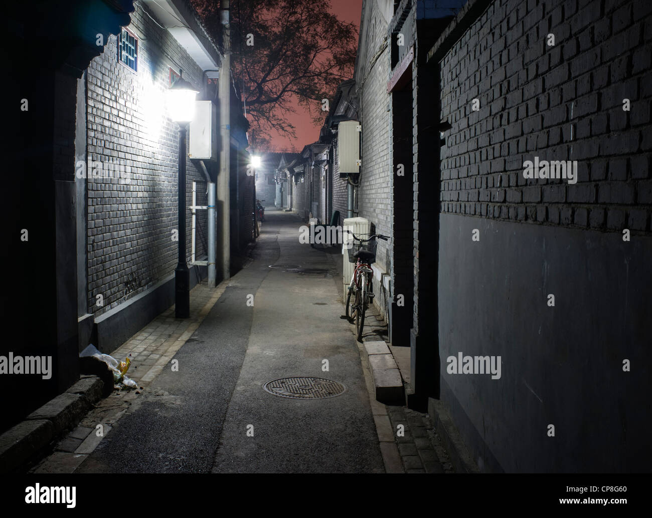 View of historic lane or hutong at night in Beijing China - Stock Image