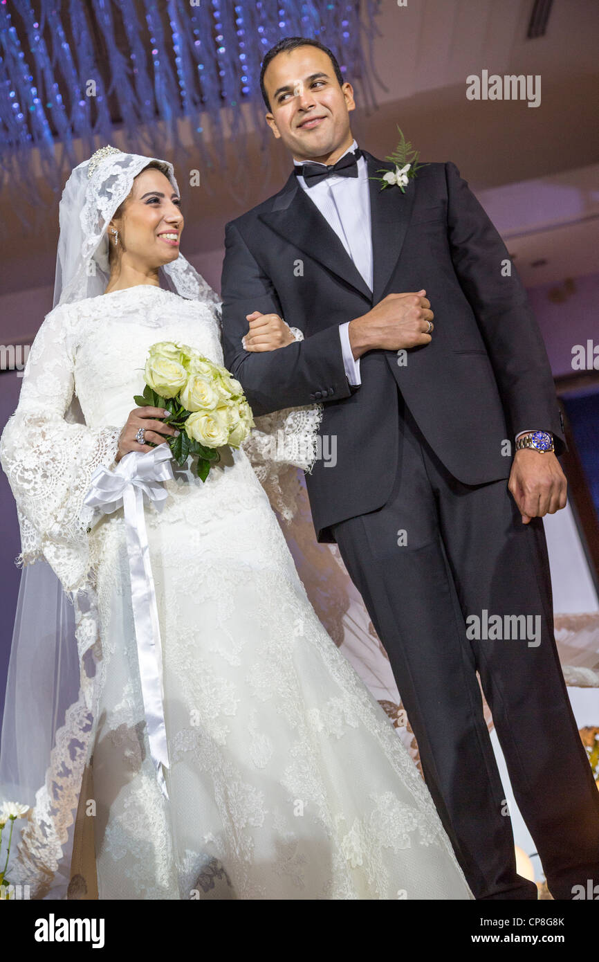 veiled bride and groom at Egyptian wedding, Cairo, Egypt - Stock Image