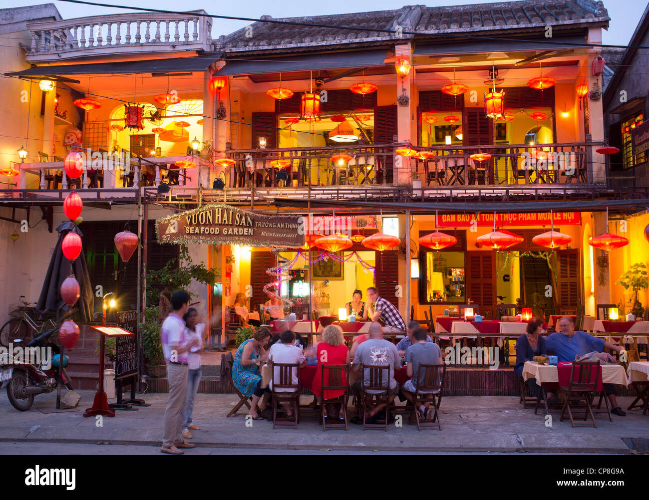 Evening view of tourist restaurant in UNESCO heritage town of Hoian in Vietnam - Stock Image