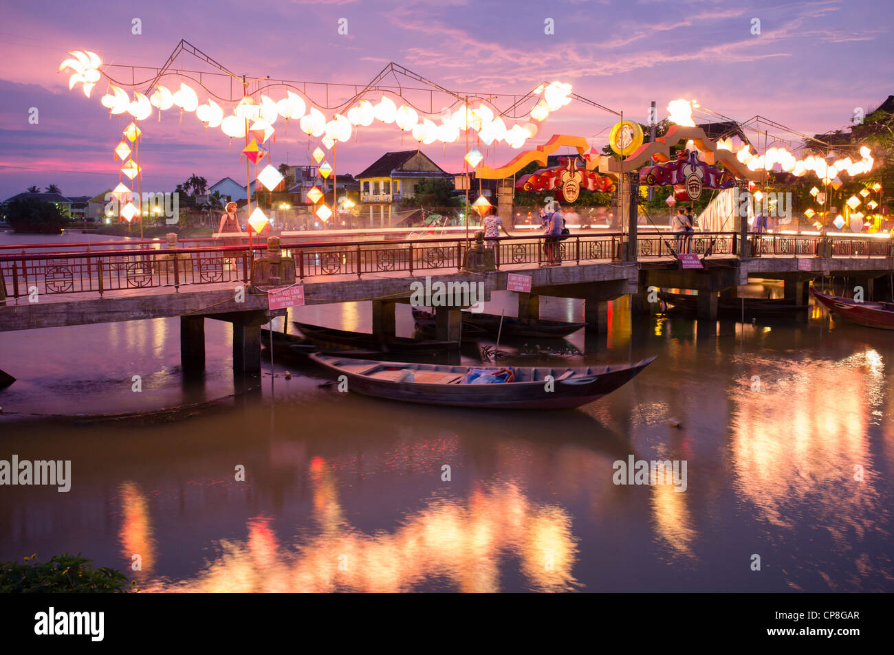 Evening view of bridge over river in historic old town of Hoian a UNESCO World Heritage site in Vietnam - Stock Image