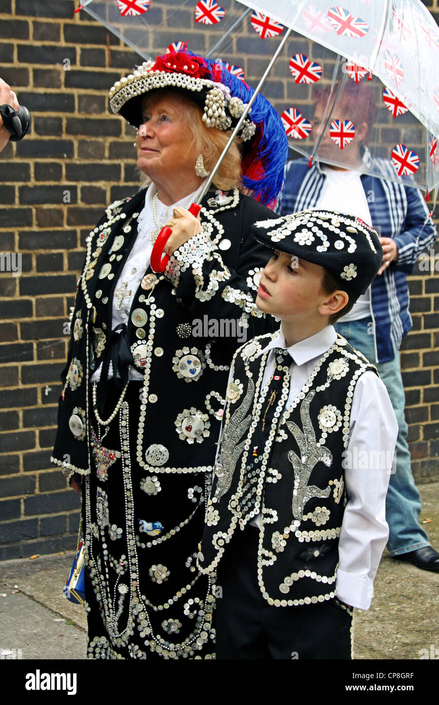 Pearly Kings and Queens outside 'The Carpenters Arms' pub in East London - Stock Image
