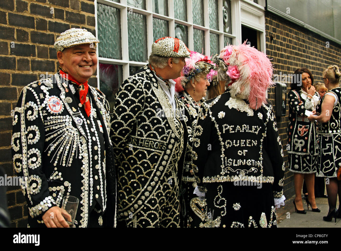 Pearly Kings and Queens at 'The Carpenters Arms' pub,London, celebrating the largest crowning of Pearly - Stock Image
