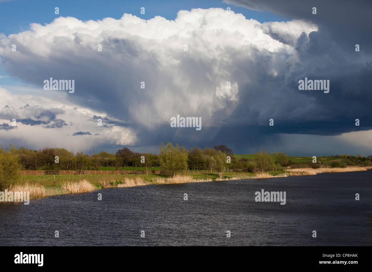 Storm clouds over Dorney Wetlands nature reserve in Dorney, Buckinghamshire, UK Stock Photo