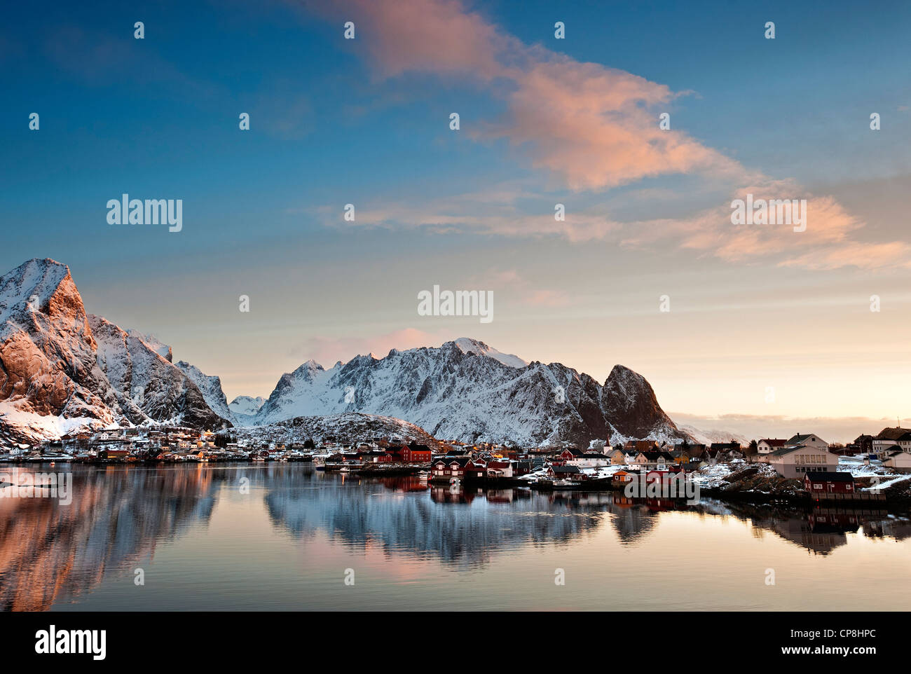Sunrise over Olstind with Reine village in the foreground Stock Photo