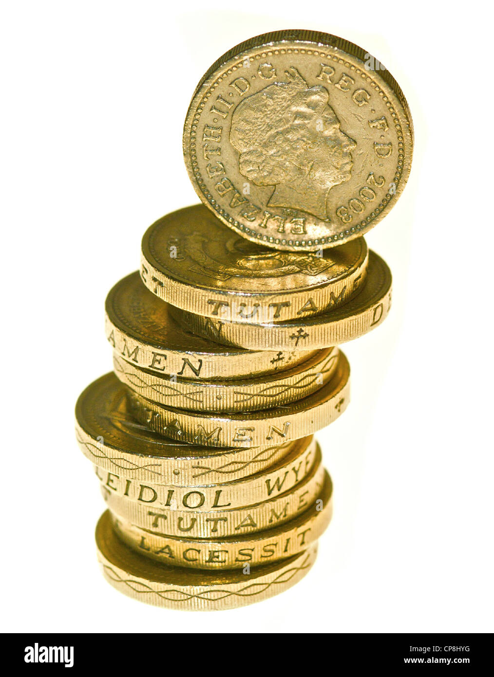 One pound coins in a pile. - Stock Image