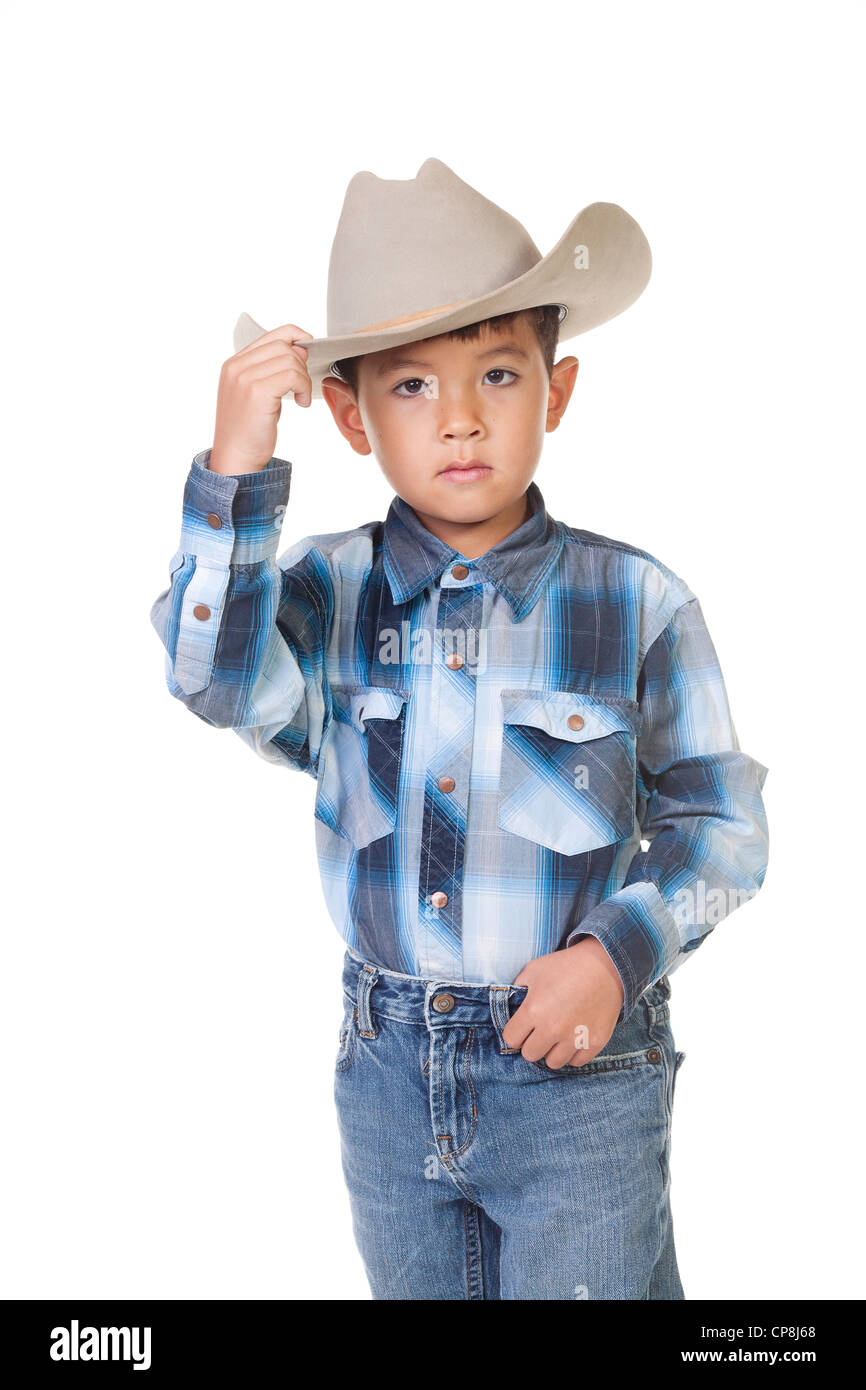 A little boy in cowboy outfit shows his