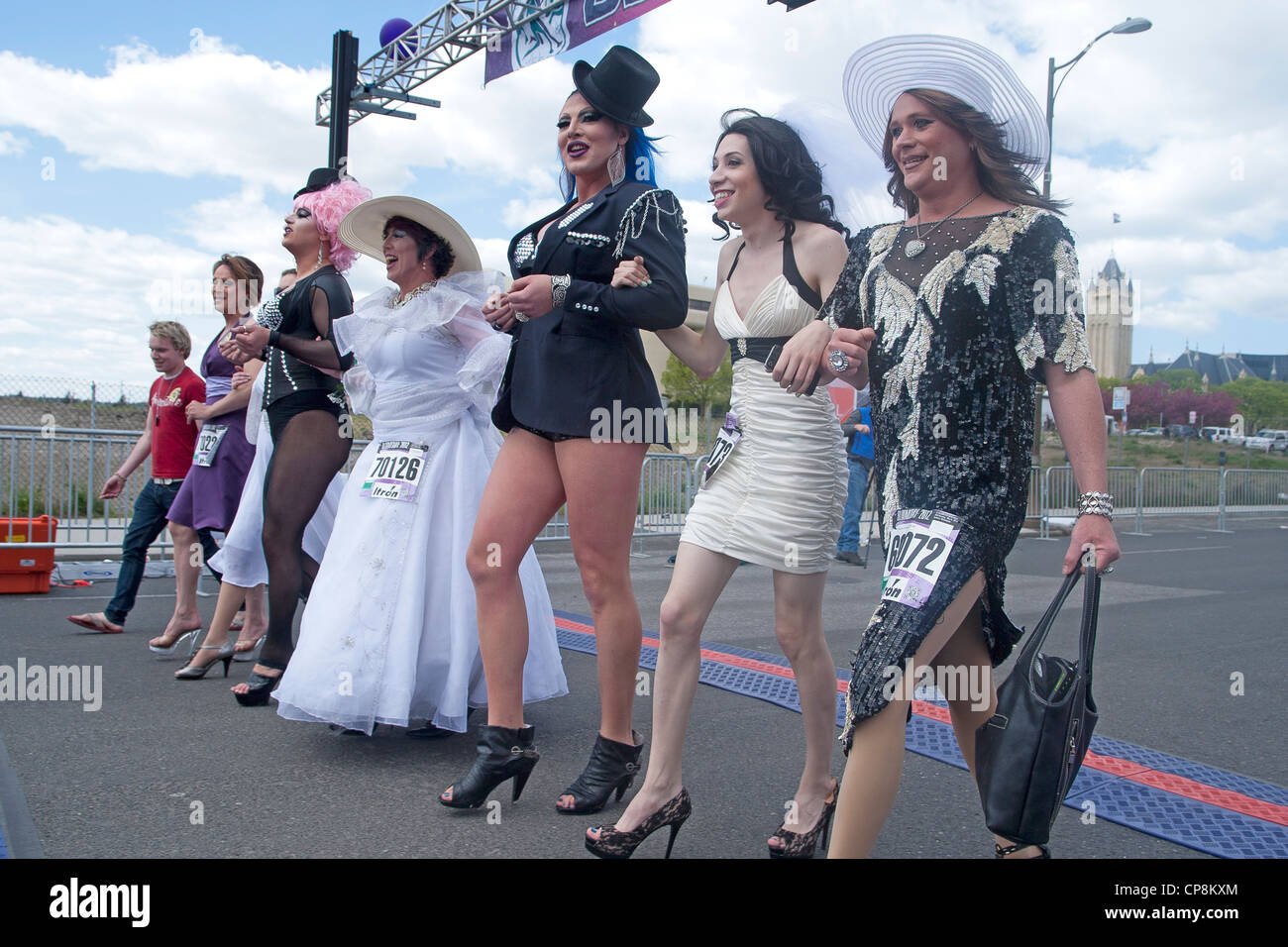 Spokane, Washington - May 6, 2012. Local drag queens walk the entire 7 1/2 miles in high heels at the bloomsday - Stock Image