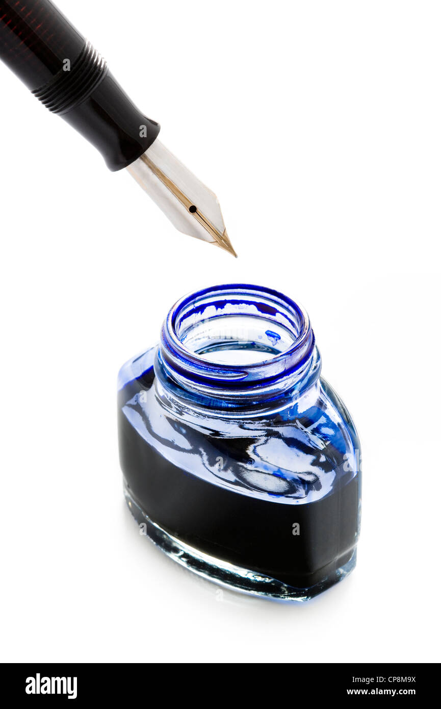 filling a fountain pen with blue ink from a bottle isolated on a white background - Stock Image