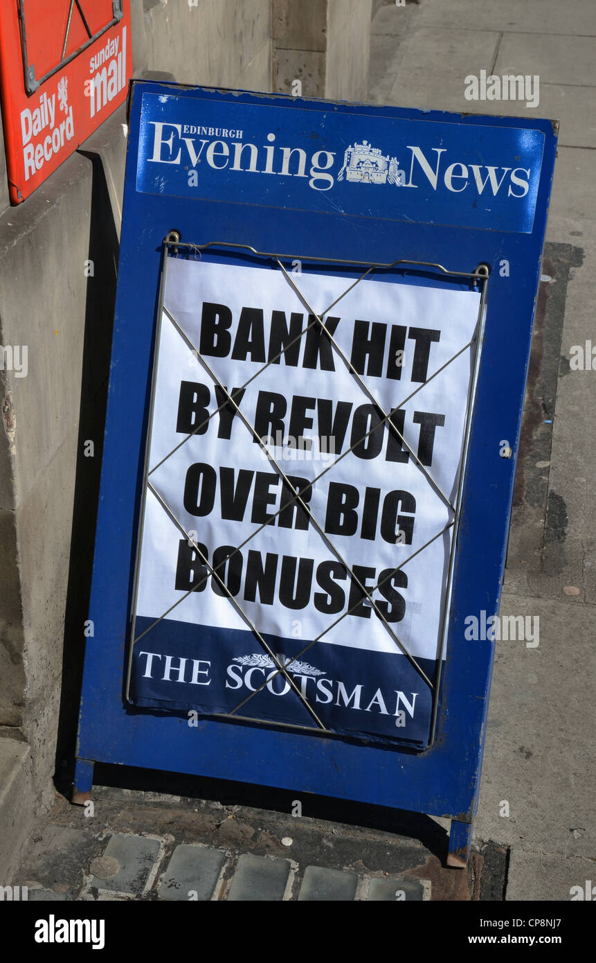 Newspaper billboard headline about shareholder revolt over big bonuses for bankers. - Stock Image