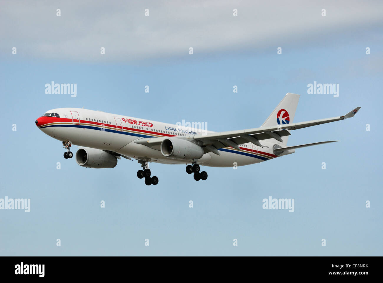 China Eastern AirBus A330-200 On final approach. - Stock Image