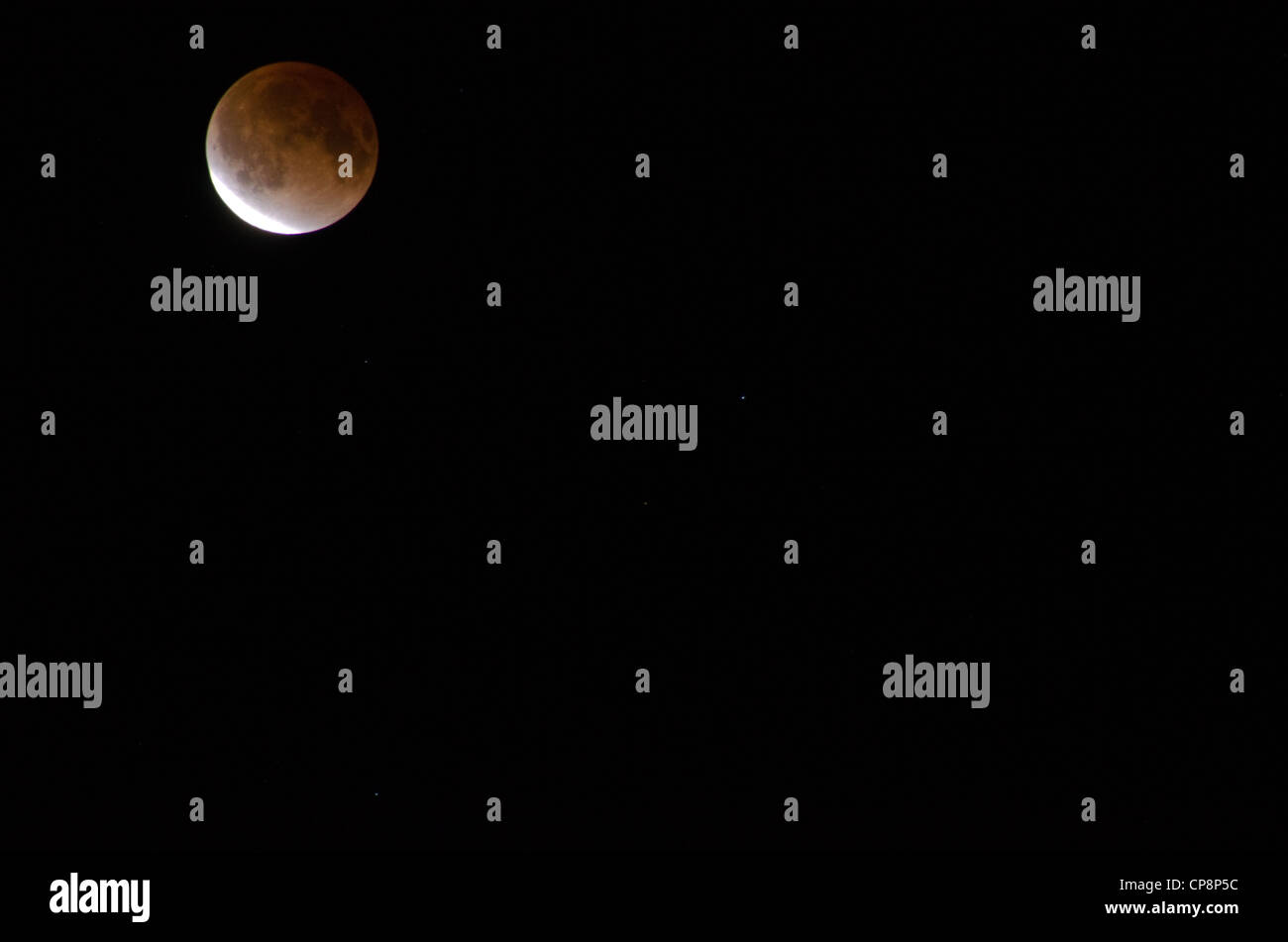 Red moon during a lunar eclipse on a black sky - Stock Image