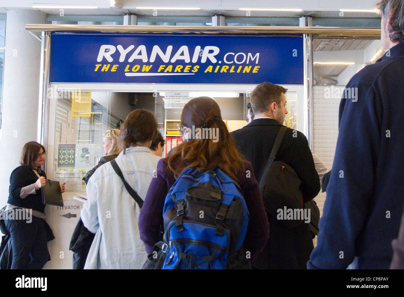 Ryanair desk cartel passengers row airport departure Spain - Stock Image