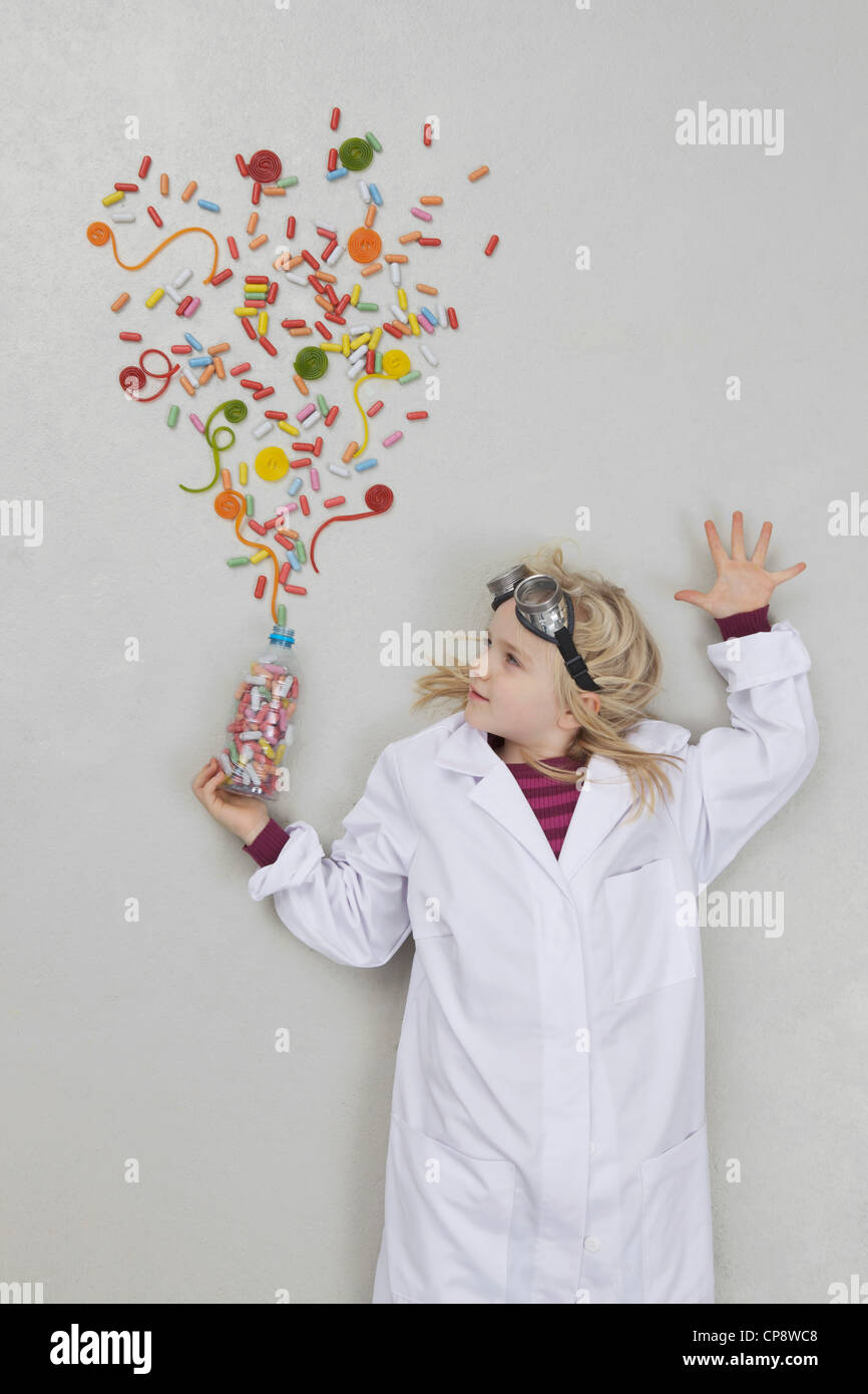 Girl doing experiment - Stock Image