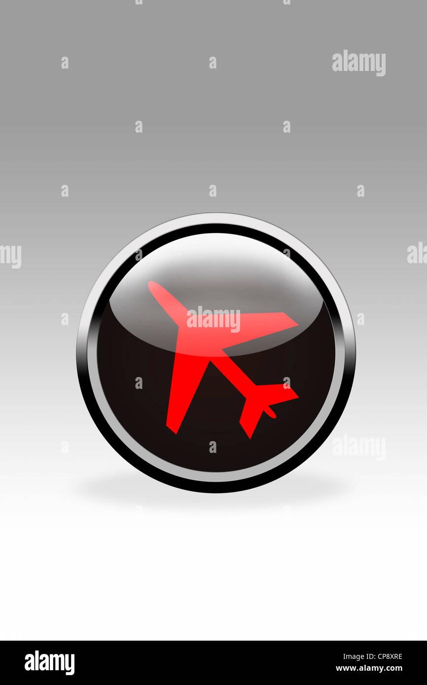 Black button showing aeroplane symbol, close up - Stock Image