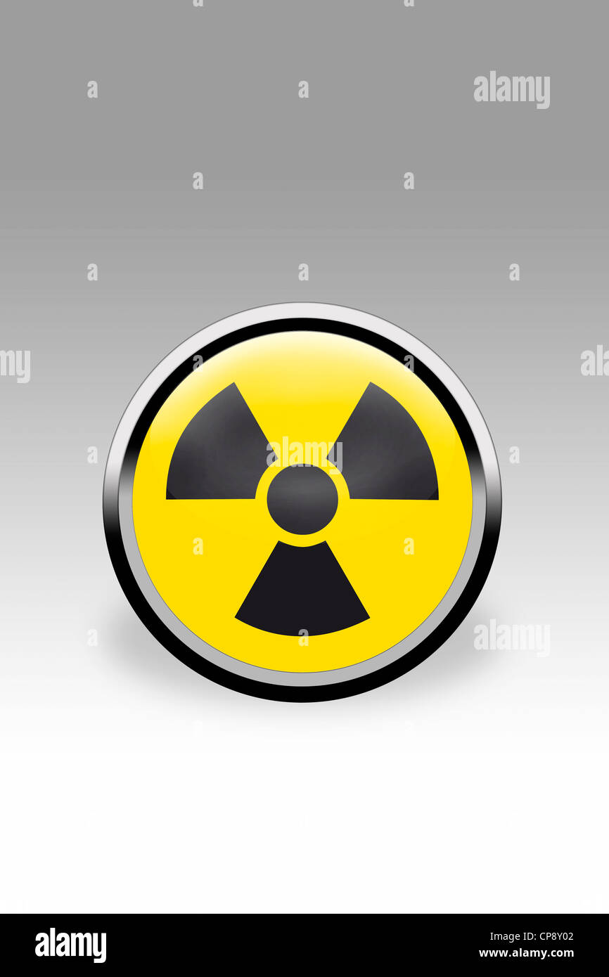 Yellow button showing nuclear power sign, close up - Stock Image