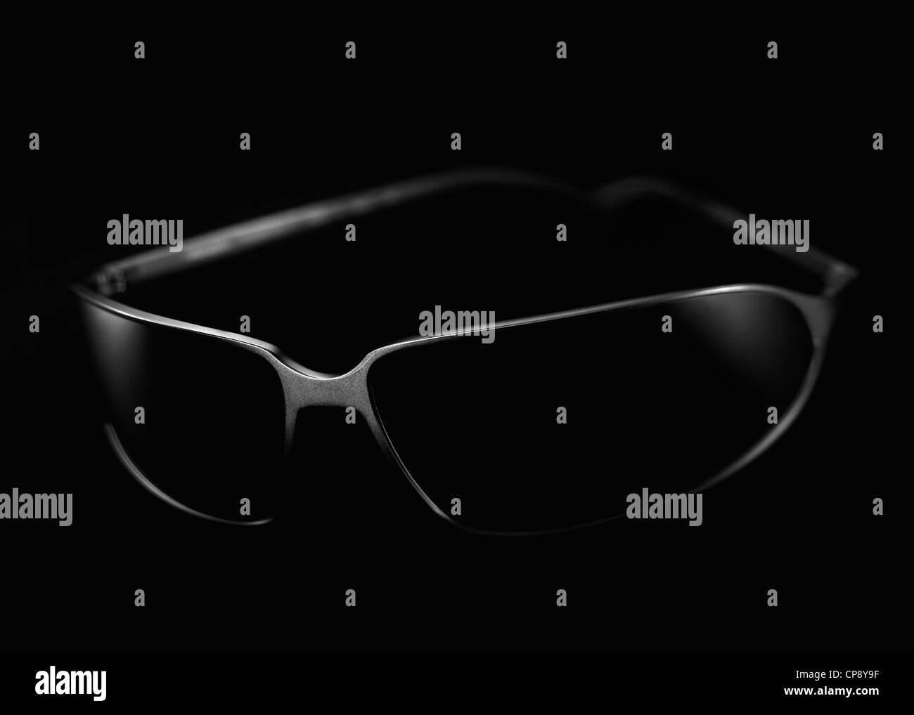 Sunglass on black background, close up - Stock Image