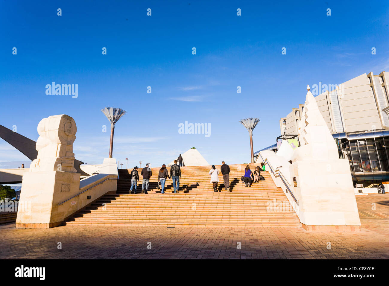 A group of people walking up the steps in Civic Square, Wellington, New Zealand. - Stock Image