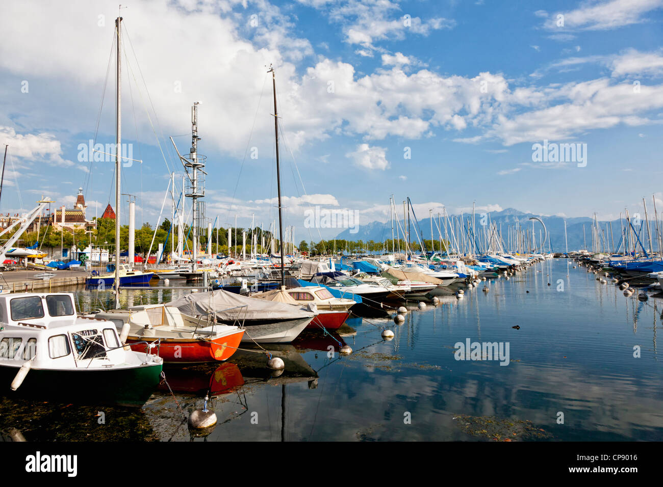 Switzerland, Lausanne, View of sailing ships moored at port - Stock Image