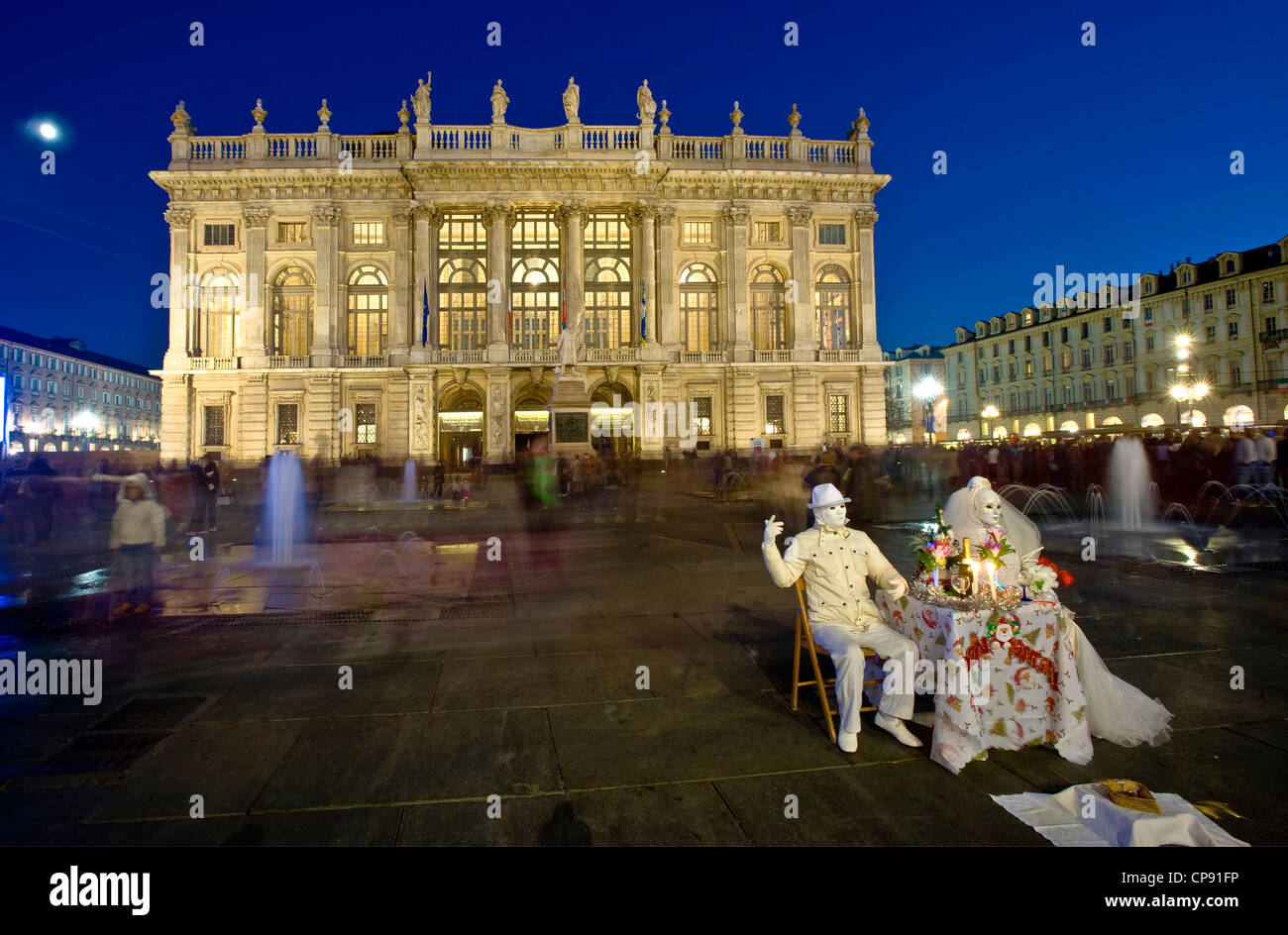 Europe Italy Piedmont Turin, Piazza Castello, the Palazzo Madama and Two street performer - Stock Image