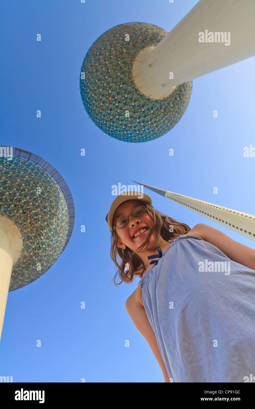 Kuwait Towers in Kuwait City with a young tourist girl in the foreground - Stock Image