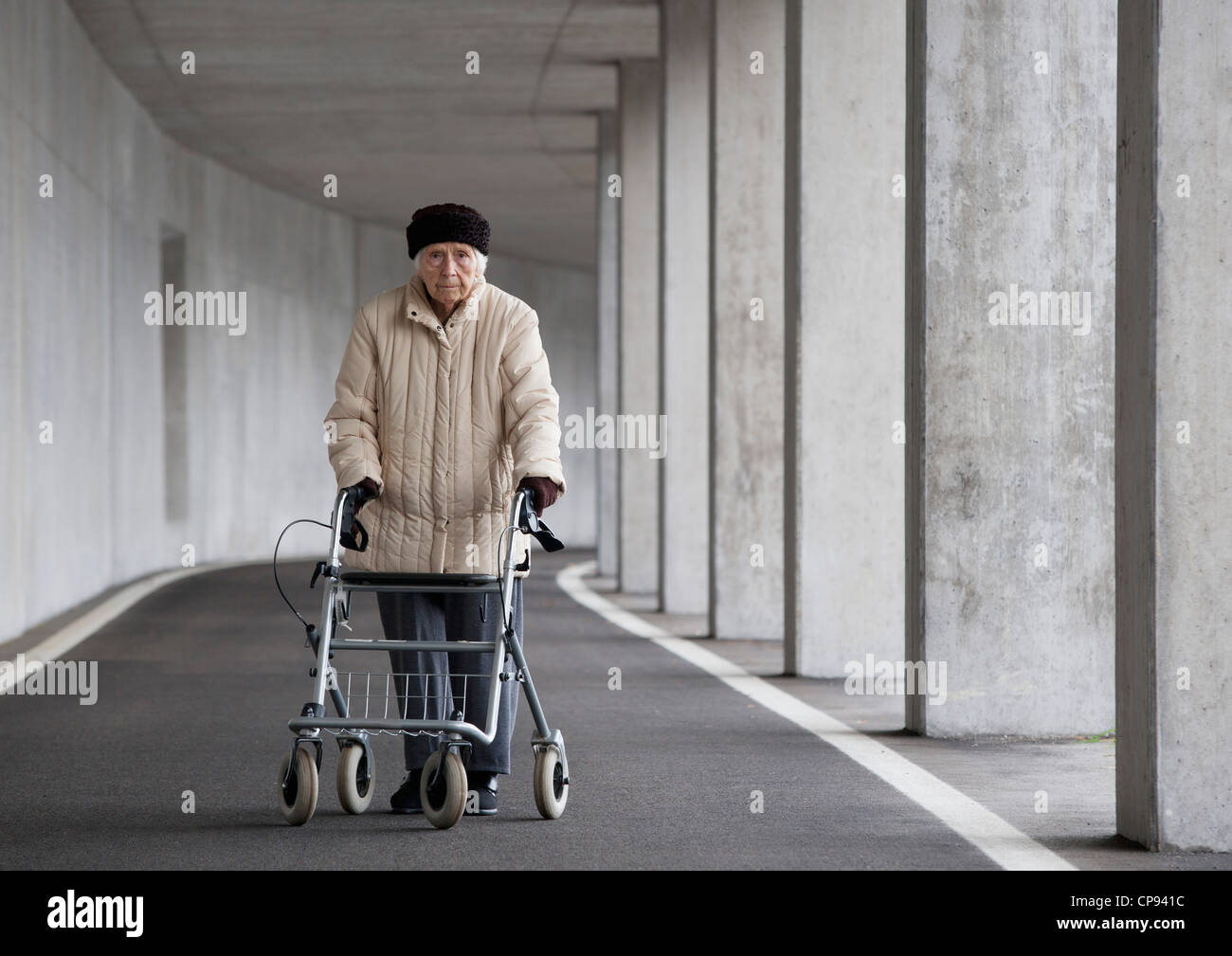 Austria, Senior woman with wheeled walker at Subway - Stock Image