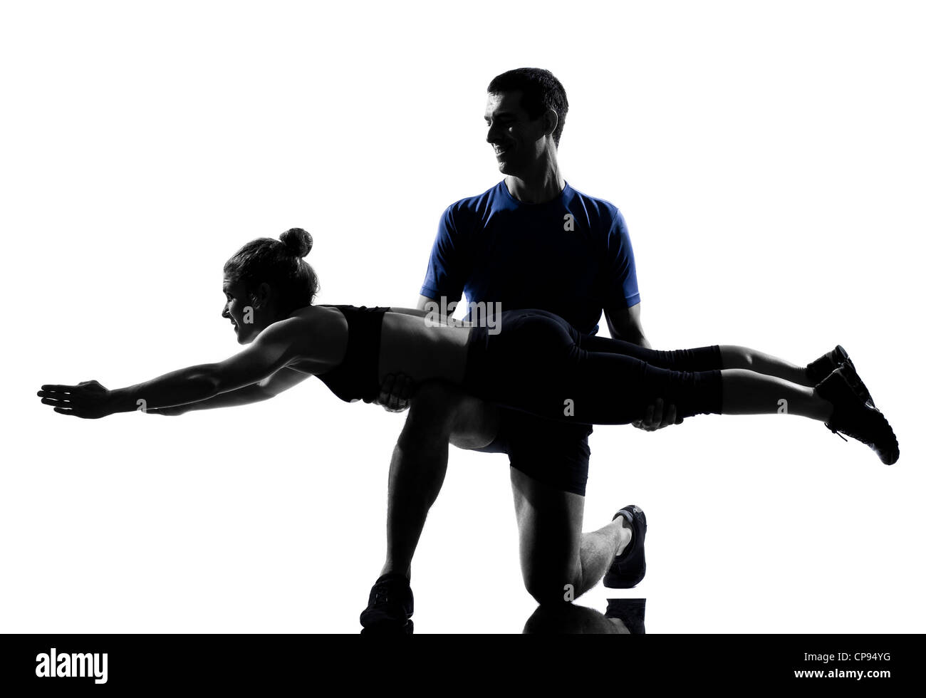 couple woman man exercising workout fitness aerobics posture in silhouette studio isolated on white background - Stock Image