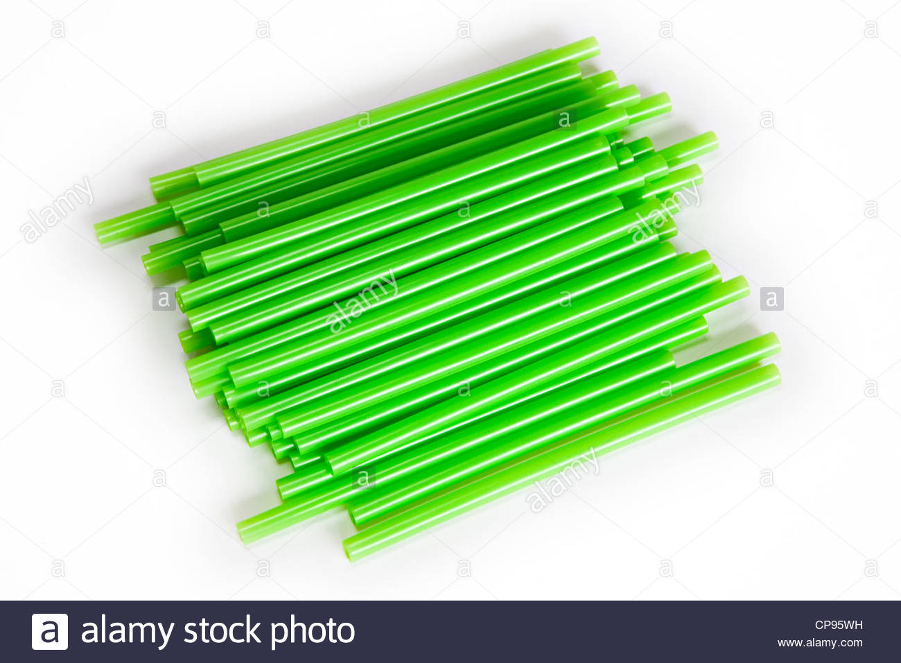 Close-up of green plastic drinking straws isolated on white with copy space - Stock Image